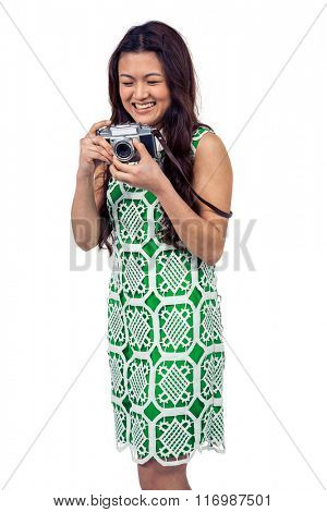 Asian woman holding digital camera on white screen
