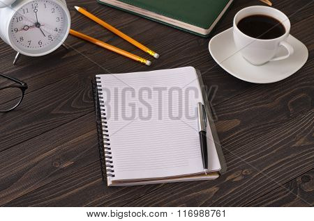 Open Notepad With Blank Pages On A Dark Office Desk