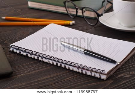 Closeup Of Open Notebook With Blank Pages And A Pen
