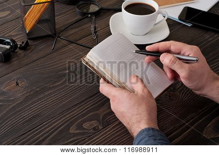 Male Writes In A Diary Closeup On The Office Desktop