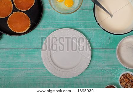 Vintage Blank White Plate On A Wooden Rustic Table