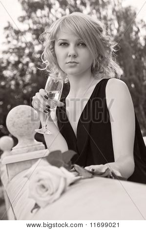 Beautiful Woman Drinking Champagne From Wineglass