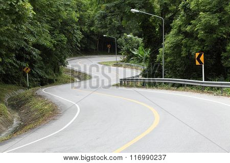 Asphalt Road Sharp Curve Along With Tropical Forest