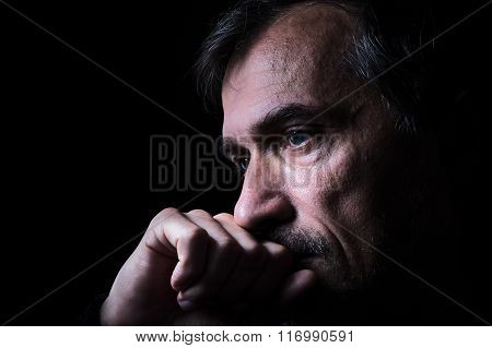 Low-key Old Man Closeup Portrait With Black Background