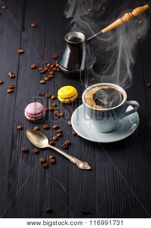 Cup coffee with grain and cezve on wooden board