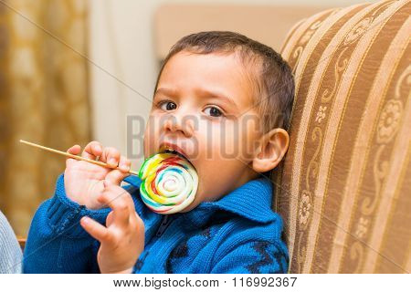Little Boy Eats Candy