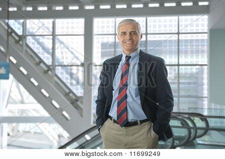 Businessman In Lobby Of Modern Building