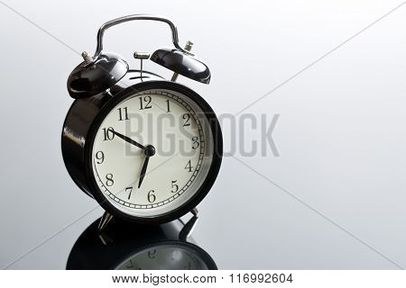 alarm clock on glass table