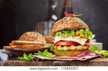 Homemade Cheeseburger With Lettuce, Tomato  And Onion