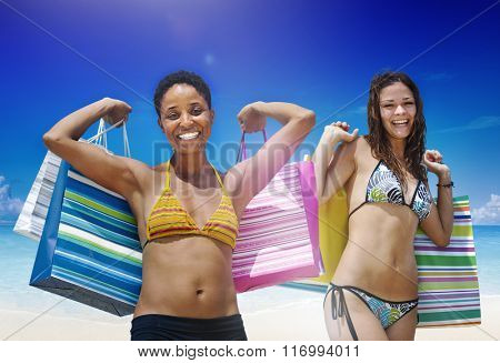 Women with shopping bags on a tropical beach concept