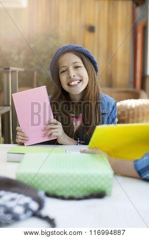 joyful laughing beautiful girl with book