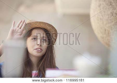 student girl raising hand at school