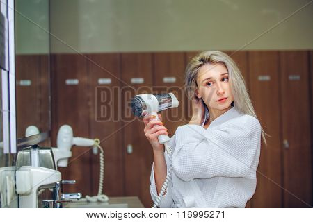 Woman dry hair hairdryer at bathroom. Female with dryer  home