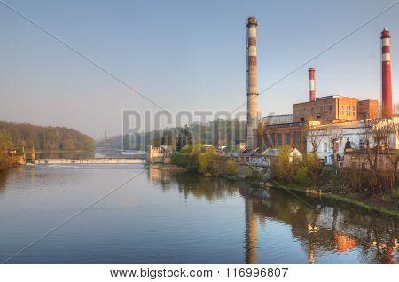 Factory at river dam