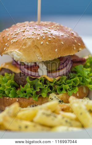 Hamburger With Fries Detail Background. Big Delicious American Hamburger With Salad, Onion, Mayonnai