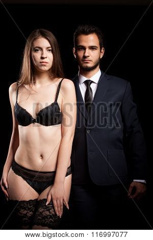 Couple In Erotic Posing On Black Background