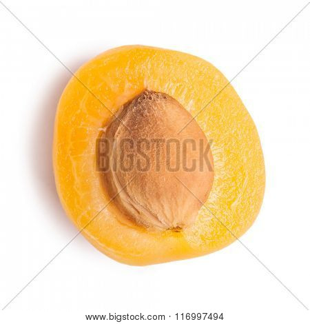 Half of apricot isolated on white background