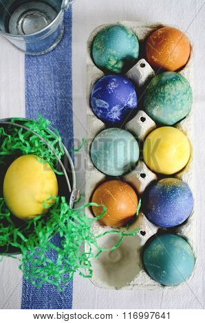 Easter coloured eggs in the paper egg box