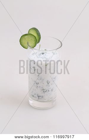 Cocktail From Kefir With A Cucumber On A White Background