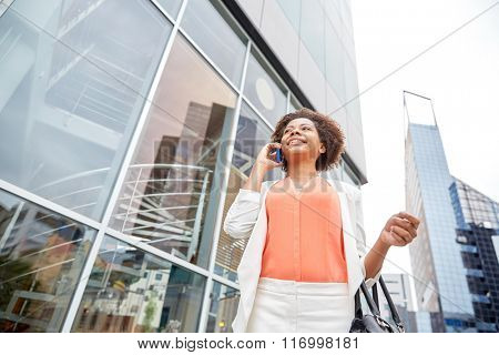 happy african businesswoman calling on smartphone