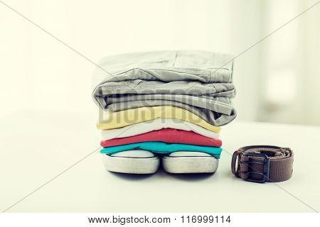 close up of clothes and accessories on table