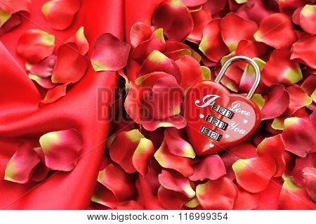 Padlock Heart-shape On A Background Of Red Petals And Satin