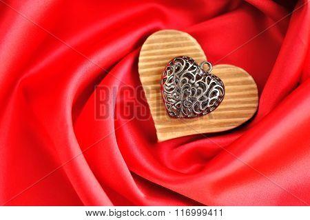 Heart Pendant On Satin Fabric Background