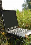 Notebook Outdoors At Grass poster
