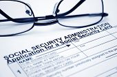 picture of social-security  - Close up of glasses on Social security card application