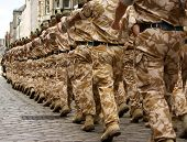 stock photo of soldiers  - british army soldiers marching in desert camouflage uniform - JPG