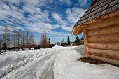 Traditional Polish Hut In Zakopane During Winter Season poster