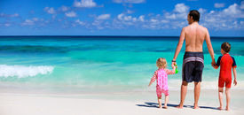 picture of family vacations  - Happy father with his two kids on tropical beach vacation - JPG