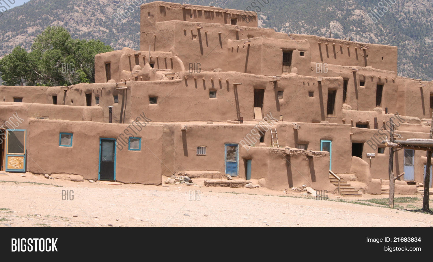 Adobe pueblo housing stock photo stock images bigstock for Pueblo home builders