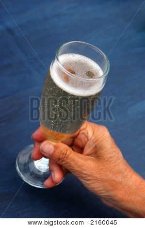 Senior Hand With Champagne Glass