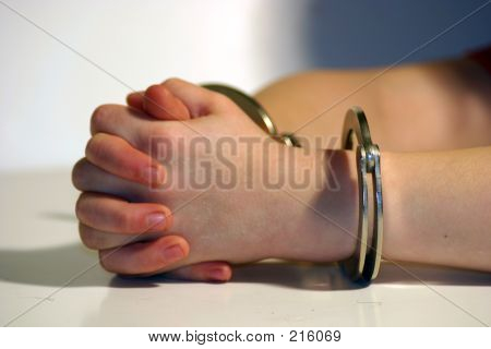 Child's Hands In Handcuffs