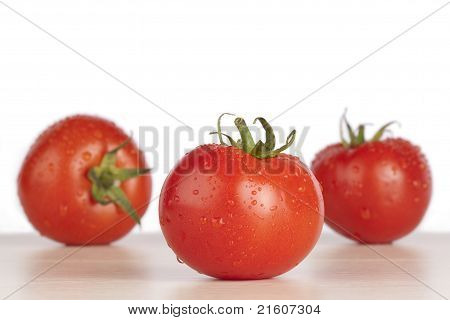 Fresh wet red tomatoes