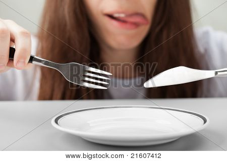 Women Hand Holding Fork And Knife
