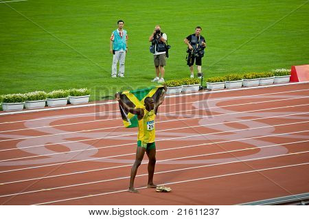 Olympic Champion Sprinter Usain Bolt Celebrates With Jamaican Flag