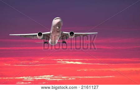 Large Jet Arriving At Sunset