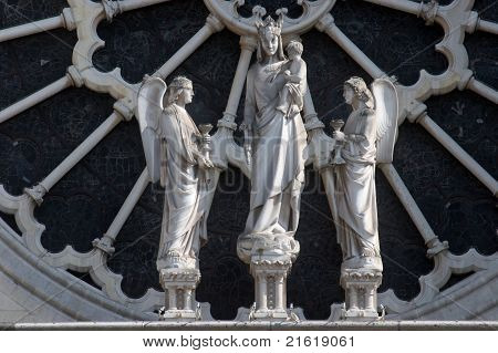 Sculpture of the Virgin and Child flanked by angels