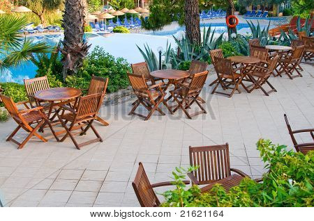 Chairs, Tables And  Swimming Pool Early Morning.