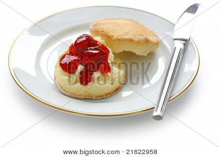 scone with strawberry jam and clotted cream