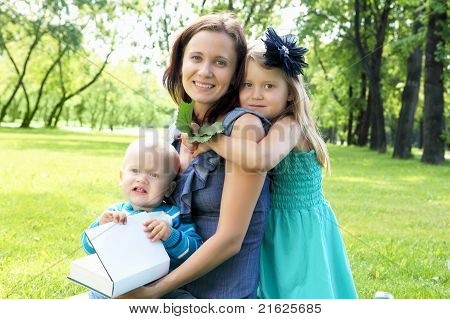 Portrait of mother with two children outdoors