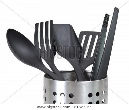 Kitchen Utensils In A Utensil Holder Isolated Against A White Background
