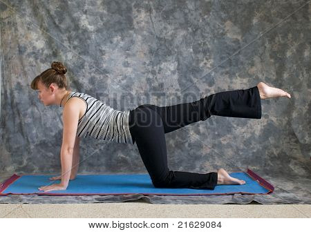Woman Doing Yoga One Leg Table Pose Right