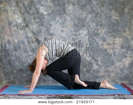 Woman Doing Yoga Posture Marjaryasana Variation Or Strong Cat Pose Left