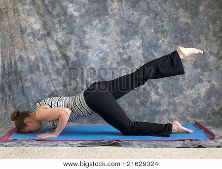 Woman Doing Yoga Posture Sunbird Pose Right