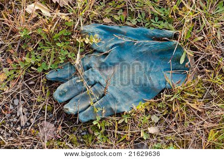 Disposed blue protective rubber glove