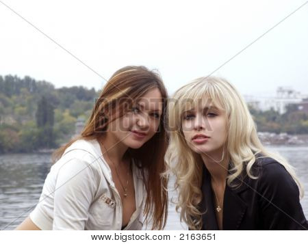 Portrait Of Two Beautiful Young Girls On The Nature 1