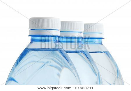 Three Plastic Mineral Water Bottles In Row